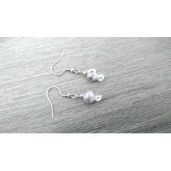 White ceramic earrings in black earth
