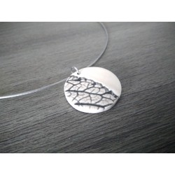White enamelled black earth pendant