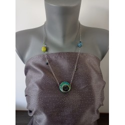 Turquoise blue, green and yellow leaf earthenware jumper on anallergic stainless steel