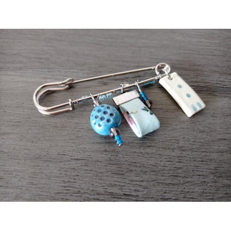 Turquoise blue earthenware and liberty brooch on anallergic stainless steel