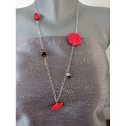 Red and black earthenware jumper on anallergic stainless steel